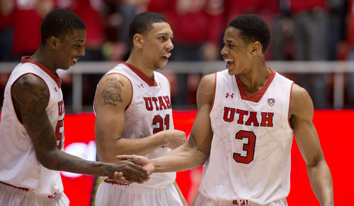 Lennie Mahler  |  The Salt Lake Tribune Delon Wright, Jordan Loveridge and Princeton Onwas celebrate after Wright tossed an alley-oop dunk to Onwas in the second half as the Utes led against the Colorado Buffaloes at the Huntsman Center, Saturday, March 1, 2014.