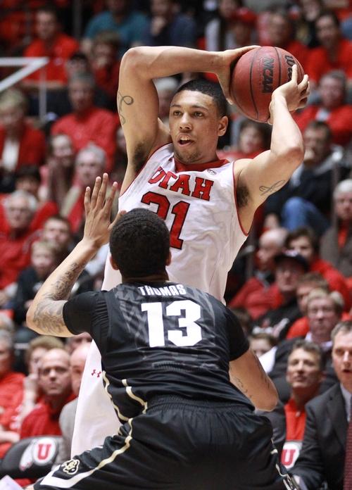 Utah's Jordan Loveridge (21) passes the ball as Colorado's Dustin Thomas (13) defends in the second half of an NCAA college basketball game Saturday, March 1, 2014, in Salt Lake City. Utah won 75-64. (AP Photo/Rick Bowmer)