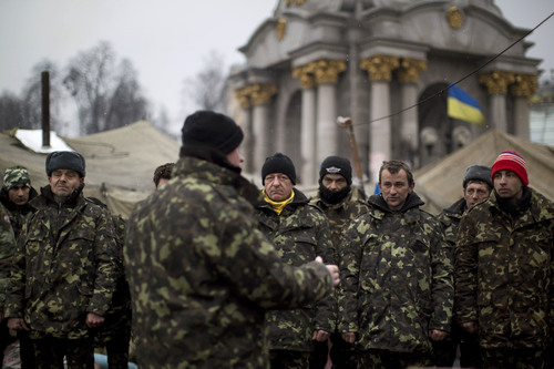 Ukrainian recruits receive instructions from a commander in a recruitment self defense quarter at Kiev's Independence Square, Ukraine, Monday, March 3, 2014. The U.S. and its allies are weighing sanctions on Moscow and whether to bolster defenses in Europe in response to Russia's military advances on Ukraine. (AP Photo/Emilio Morenatti)