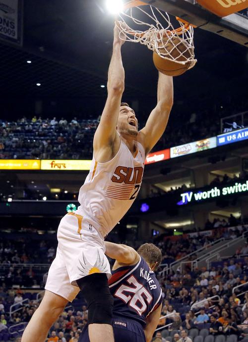 Phoenix Suns' Miles Plumlee dunks over Atlanta Hawks' Kyle Korver (26) during the second half of an NBA basketball game, Sunday, March 2, 2014, in Phoenix. The Suns won 129-120. (AP Photo/Matt York)