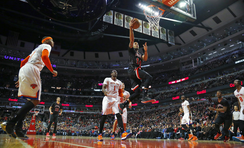 Chicago Bulls guard D.J. Augustin (14) goes in for a lay-up against the New York Knicks during the second half of an NBA basketball game Sunday, March 2, 2014, in Chicago. The Bulls won the game 109-90. (AP Photo/Jeff Haynes)