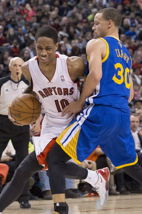 Toronto Raptors' DeMar DeRozan, left, drives past Golden State Warriors' Stephen Curry during second half NBA basketball action in Toronto, Sunday, March 2, 2014. (AP Photo/The Canadian Press, Chris Young)