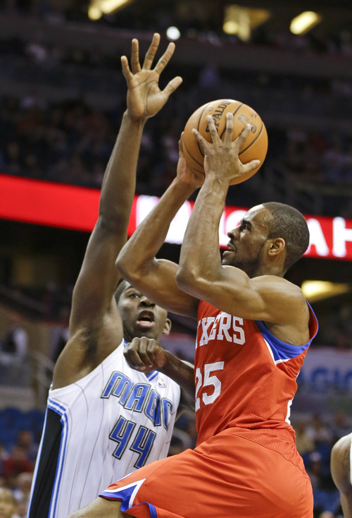 Philadelphia 76ers' Elliot Williams (25) shoots over Orlando Magic's Andrew Nicholson (44) during the first half of an NBA basketball game in Orlando, Fla., Sunday, March 2, 2014. (AP Photo/John Raoux)