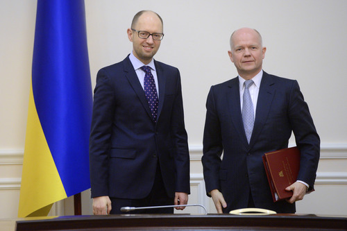Ukrainian Prime Minister Arseniy Yatsenyuk, left, and British Foreign Secretary William Hague pose for a photograph prior to their meeting in Kiev, Ukraine, Monday, March 3, 2014. Pro-Russian troops took over a ferry terminal on the easternmost tip of Crimea close to Russia on Monday, exacerbating fears that Moscow is planning to bring even more troops into this strategic Black Sea region. (AP Photo/Andrew Kravchenko, Pool)