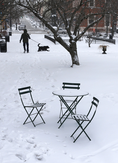 Snow rests on outdoor furniture in a park in Baltimore, Monday, March 3, 2014. Winter kept its icy hold on much of the country Monday, with snow falling and temperatures dropping as schools and offices closed and people from the Mid-Atlantic to Northeast reluctantly waited out another storm indoors. (AP Photo/Patrick Semansky)