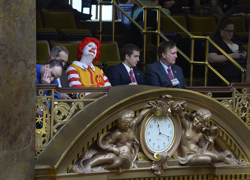 "Scott Sommerdorf      The Salt Lake Tribune ""Ronald McDonald"" examines the roof of the Utah House of Representatives while he visited the Legislature, Thursday, Feb. 6, 2014."