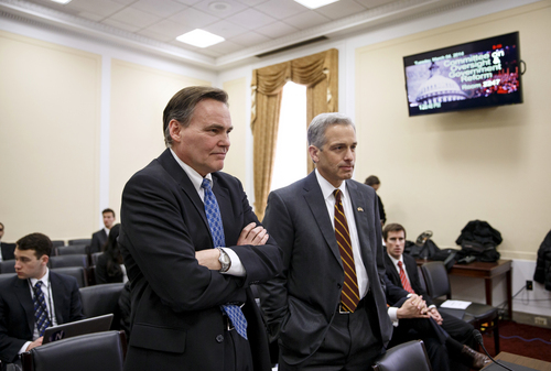 Drug Enforcement Administration (DEA) Deputy Administrator Thomas M. Harrigan, left, and U.S. Attorney for the District of Colorado John Walsh, prepare to testify on Capitol Hill in Washington, Tuesday, March 4, 2014, before the House Oversight subcommittee on Government Operations on the Obama Administration's policies on marijuana.  (AP Photo/J. Scott Applewhite)