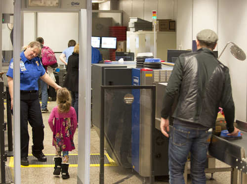 Lennie Mahler  |  The Salt Lake Tribune Travelers pass through the expedited security line in Salt Lake City International Airport, Tuesday, March 4, 2014. Enrollment in the new TSA Pre-Check program grants passengers an ID number for $85 that allows access to the expedited security line for five years.