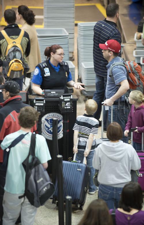 Lennie Mahler  |  The Salt Lake Tribune A TSA worker verifies ID of travelers in Salt Lake City International Airport, Tuesday, March 4, 2014.