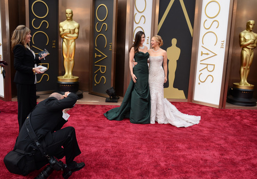 Idina Menzel, left, and Kristen Bell arrive at the Oscars on Sunday, March 2, 2014, at the Dolby Theatre in Los Angeles.  (Photo by Jordan Strauss/Invision/AP)