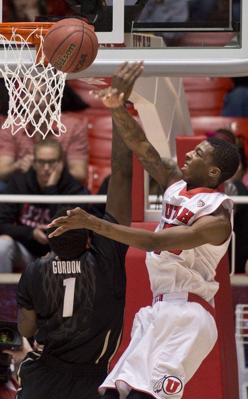 Lennie Mahler  |  The Salt Lake Tribune Utah's Delon Wright swats a lay-up by Colorado's Wesley Gordon in the first half of a game at the Huntsman Center, Saturday, March 1, 2014.