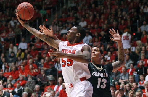 Utah's Delon Wright (55) goes to the basket as Colorado's Dustin Thomas (13) defends in the second half of an NCAA college basketball game Saturday, March 1, 2014, in Salt Lake City. Utah won 75-64. (AP Photo/Rick Bowmer)