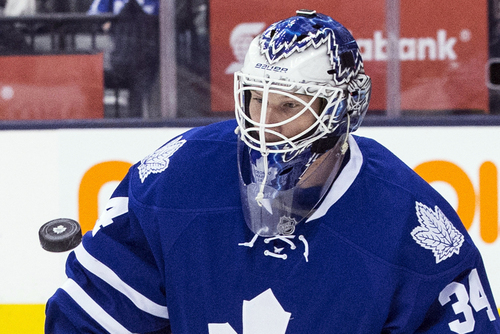 Toronto Maple Leafs goalie James Reimer makes a save against Columbus Blue Jackets during the first period of an NHL hockey game in Toronto on Monday, March 3, 2014. (AP Photo/The Canadian Press, Chris Young)