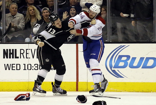 Montreal Canadiens defenseman Jarred Tinordi (24) and Los Angeles Kings left winger Kyle Clifford (13) fight in the first period of an NHL hockey game in Los Angeles Monday, March 3, 2014. (AP Photo/Reed Saxon)