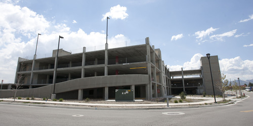 Steve Griffin |   Tribune file photo  Two parking garages at the Jordan Valley TRAX station in West Jordan sit mostly empty.