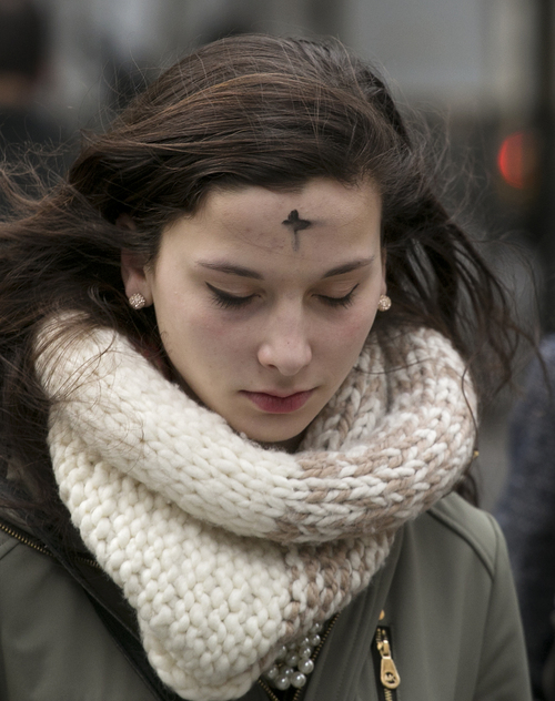 A woman leaves an Ash Wednesday service at St. Patrick's Cathedral, Wednesday, March 5, 2014 in New York. Some Protestant, and all Catholic churches, distribute ashes on the forehead as a sign of repentance and renewal on Ash Wednesday as the 40-day season leading to Easter begins. (AP Photo/Mark Lennihan)