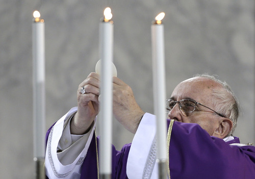 Pope Francis celebrates the Ash Wednesday mass at the Santa Sabina Basilica in Rome, Wednesday, March 5, 2014. Ash Wednesday marks the beginning of Lent, a solemn period of 40 days of prayer and self-denial leading up to Easter. (AP Photo/Max Rossi, Pool)