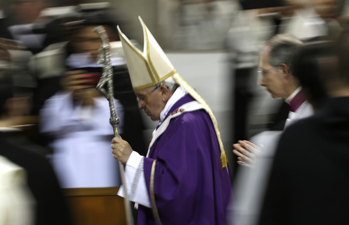 Pope Francis leaves after celebrating the Ash Wednesday mass at the Santa Sabina Basilica in Rome, Wednesday, March 5, 2014. Ash Wednesday marks the beginning of Lent, a solemn period of 40 days of prayer and self-denial leading up to Easter. (AP Photo/Max Rossi, Pool)