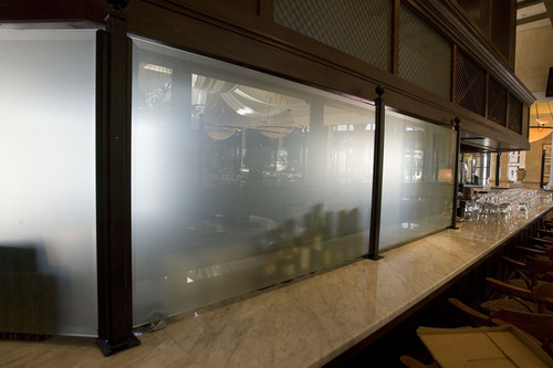 Paul Fraughton  |  Tribune file photo Conforming to Utah's liquor law, a frosted glass curtain hides a portion of the bar at Brio Tuscan Grille at Fashion Place Mall.