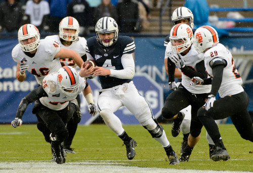 Trent Nelson  |  The Salt Lake Tribune Brigham Young Cougars quarterback Taysom Hill (4) runs the ball as BYU hosts Idaho State, college football at LaVell Edwards Stadium in Provo, Saturday November 16, 2013.