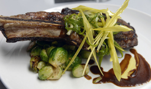 Al Hartmann  |  The Salt Lake Tribune  T-Bone steak with brussel sprouts at Bistro 222.