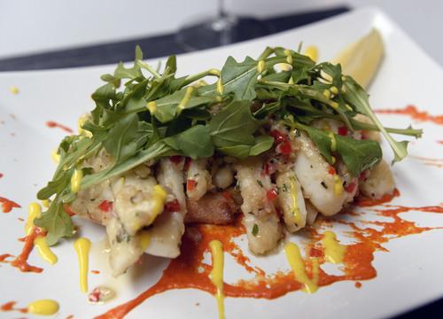 Al Hartmann  |  The Salt Lake Tribune  Calamari Steak Saute appetizer with garlic, rosemary, lemon and wild arugula at Bistro 222.