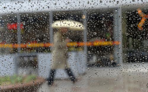 Al Hartmann  |  The Salt Lake Tribune A pedestrian with an umbrella passes along Main Street in Salt Lake City Tuesday March 4, 2014, during a rainstorm.