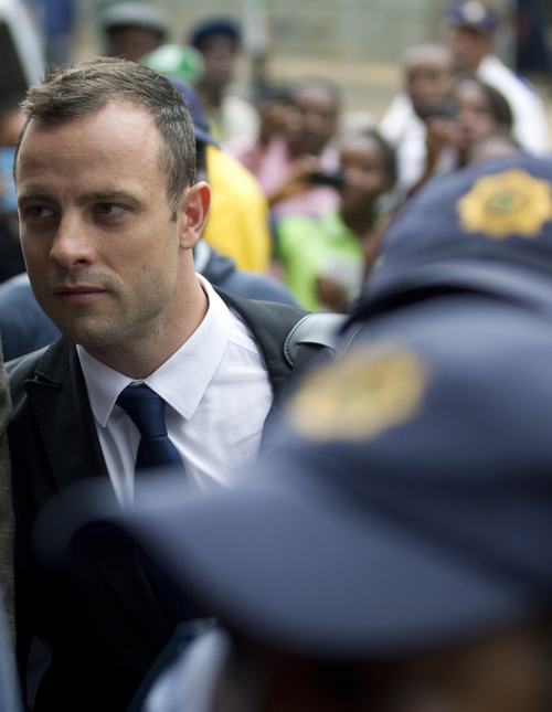 Oscar Pistorius arrives at the high court in Pretoria, South Africa, Thursday, March 6, 2014. Pistorius is charged with murder for the shooting death of his girlfriend Reeva Steenkamp on Valentine's Day in 2013. (AP Photo/Themba Hadebe)