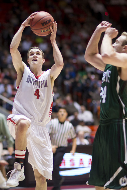 Lennie Mahler  |  The Salt Lake Tribune Bountiful's Jordan Bleak shoots over Olympus' Alex Williams in the first half of a semi-final game at the Huntsman Center, Friday, March 7, 2014.