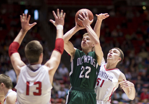 Lennie Mahler  |  The Salt Lake Tribune Olympus' Jordan Meacham shoots over Bountiful's Jeff Pollard, left, and Andrew Lund, right, in the second half of a semi-final game at the Huntsman Center, Friday, March 7, 2014.