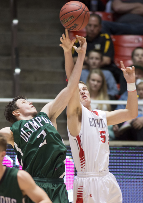 Lennie Mahler  |  The Salt Lake Tribune Olympus' Connor Haller and Bountiful's Sam Merrill fight for a rebound in the second half of a semi-final game against Olympus at the Huntsman Center, Friday, March 7, 2014.