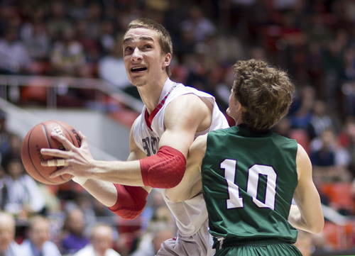 Lennie Mahler  |  The Salt Lake Tribune Bountiful's Jeff Pollard posts up on Olympus' Seth Crofts in the first half of a semi-final game at the Huntsman Center, Friday, March 7, 2014.