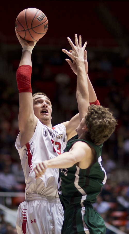 Lennie Mahler  |  The Salt Lake Tribune Bountiful's Jeff Pollard shoots over Olympus' Seth Crofts in the first half of a semi-final game at the Huntsman Center, Friday, March 7, 2014.