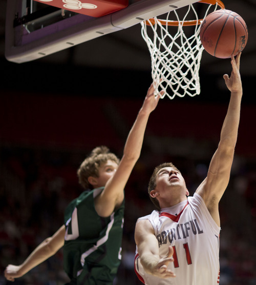 Lennie Mahler  |  The Salt Lake Tribune Bountiful's Trevor Lloyd shoots a reverse lay-up by Olympus' Seth Crofts in the first half of a semi-final game at the Huntsman Center, Friday, March 7, 2014.