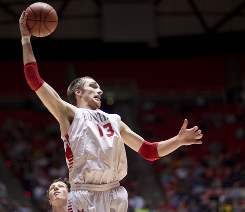 Lennie Mahler  |  The Salt Lake Tribune Bountiful's Jeff Pollard corrals a rebound in the first half of a semi-final game against Olympus at the Huntsman Center, Friday, March 7, 2014.