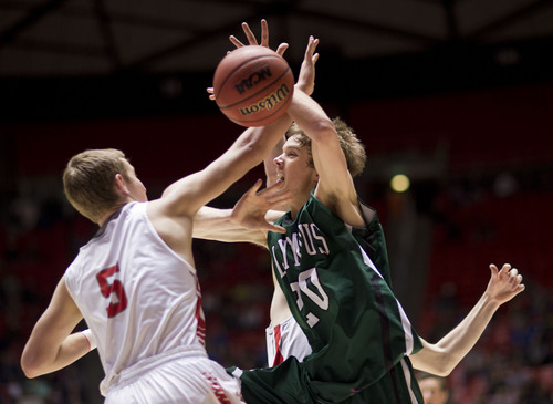 Lennie Mahler  |  The Salt Lake Tribune Olympus' Alec Monson is fouled by Bountiful's Sam Merrill in the second half of a semi-final game at the Huntsman Center, Friday, March 7, 2014.