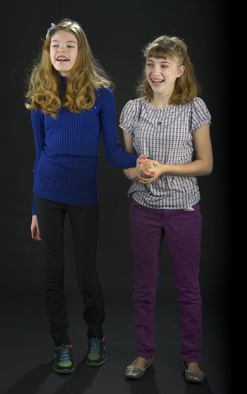 Leah Hogsten  |  The Salt Lake Tribune l-r Jessie Christensen, 13, and Kimmie Hansen, 15, have recently become friends through functions held by families involved in the Dravet Syndrome support group. Kimmie loves to tickle Jessie and make her laugh.