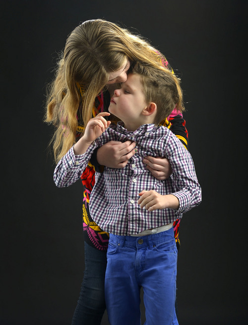 Leah Hogsten  |  The Salt Lake Tribune Connor Campbell, 6, receives much love and understanding from his older sister, Katie, age 11, in managing his Intractable Epilepsy and the more than 100 seizures he has daily.