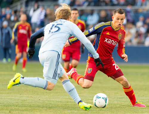 Trent Nelson  |  The Salt Lake Tribune Real Salt Lake's Luis Gil (21) and Sporting KC's Seth Sinovic (15) compete for the ball as Real Salt Lake faces Sporting KC in the MLS Cup Final at Sporting Park in Kansas City, Saturday December 7, 2013.
