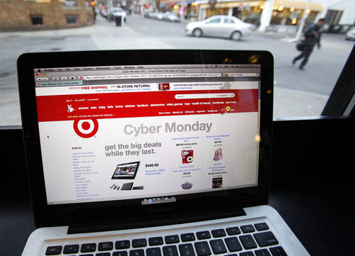 FILE - In this Monday, Nov. 28, 2011, file photo, the Target web site is photographed on a computer screen at a coffee shop in Providence, R.I.. American shoppers say they are very concerned about the safety of their personal information following a massive security breach at Target, but most aren't doing anything to ensure their data is secure, says a new Associated Press--GfK Poll released Monday, Jan. 27, 2014. (AP Photo/Michael Dwyer, File)