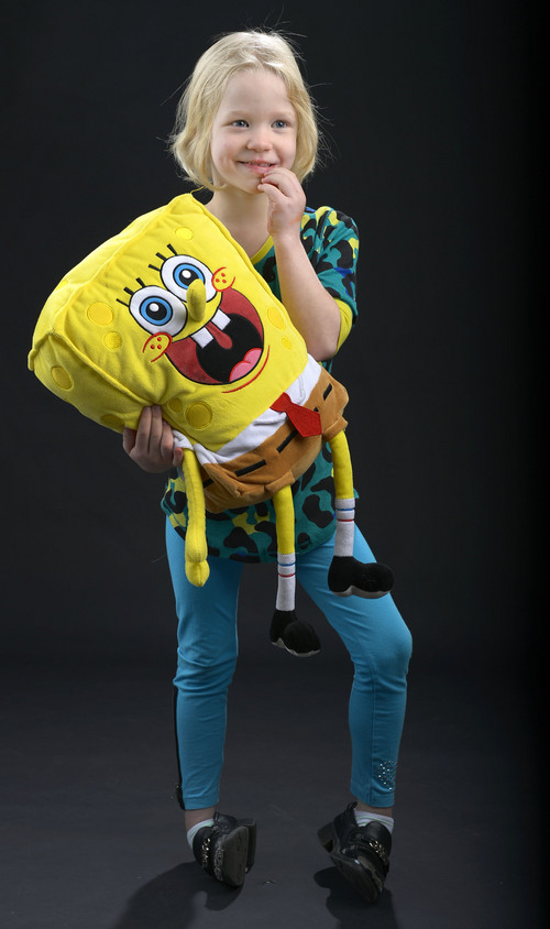 Leah Hogsten  |  The Salt Lake Tribune Charley Grossman, 7, rarely leaves home without her Spongebob Squarepants stuffed doll. Charley, the youngest of four siblings has Intractable Epilepsy and seizes multiple times every day.