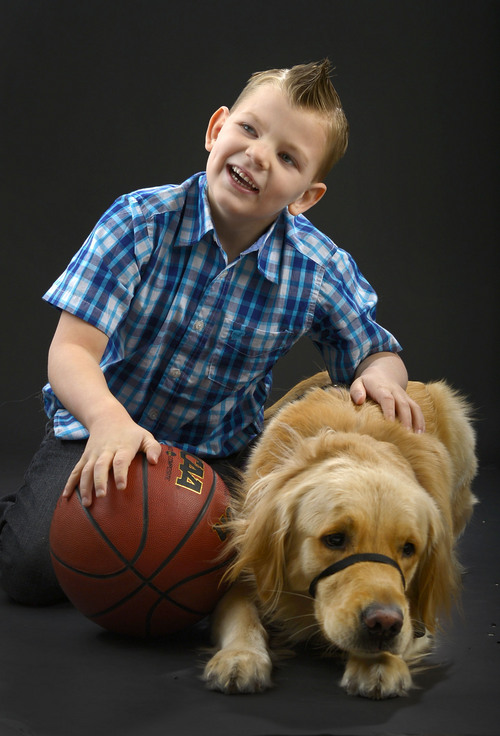 Leah Hogsten  |  The Salt Lake Tribune Porter Holmes, 6, has a constant companion in Thumper, his service dog of one year to help with his seizures stemming from Dravet syndrome.