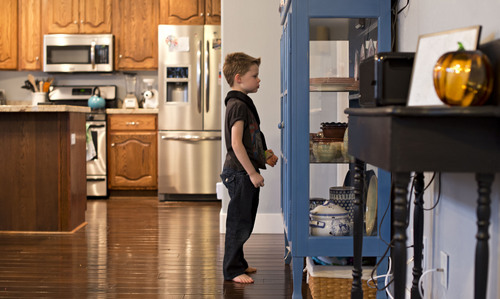 Lennie Mahler     The Salt Lake Tribune Connor Campbell, 6, examines his reflection in the cupboard at his home in Cedar Hills, Utah, on Friday, Nov. 22, 2013. Connor battles a severe form of epilepsy and experiences seizures almost constantly, which have inhibited mental development. At times he will move around the house in patterns, repeating the same actions over and over. This includes examining his relections or shadows on walls, flipping light switches and opening then closing the washer door.