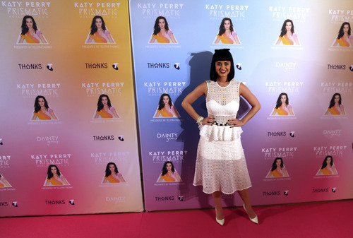 Singer Katy Perry poses for photos during the launch of her Prismatic World Tour in Sydney, Australia, Tuesday, March 4, 2014. Perry will perform live on stage at concerts in Perth, Adelaide, Melbourne, Sydney and Brisbane, kicking off on Nov. 7, 2014.(AP Photo/Rob Griffith)