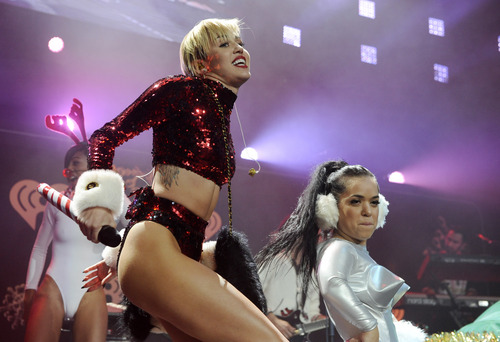 """FILE - This Dec. 6, 2013 file photo shows Miley Cyrus performing during the KIIS-FM Jingle Ball concert at Staples Center in Los Angeles. MTV has declared that Miley Cyrus is the best artist of the year. MTV said Monday, Dec. 9, that the VMA duet on """"We Can't Stop"""" and """"Blurred Lines"""" was the year's most-watched video on MTV web sites. Similarly, the MTV artist site devoted to Cyrus had more visits than any other artist's. (Photo by Chris Pizzello/Invision/AP, File)"""