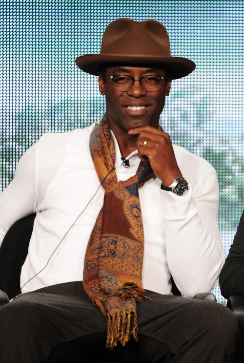 """FILE - In this Jan. 15, 2014 file photo, cast member Isaiah Washington participates in """"The 100"""" panel at the CBS Winter TCA Press Tour, at the Langham Huntington, in Pasadena, Calif. ABC says Washington will return to """"Grey's Anatomy"""" for a guest appearance in May 2014, seven years after he was fired from the medical drama. (Photo by Frank Micelotta/Invision/AP, file)"""