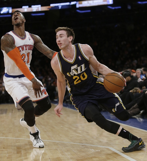 Utah Jazz's Gordon Hayward (20) drives past New York Knicks' Iman Shumpert (21) during the first half of an NBA basketball game on Friday, March 7, 2014, in New York. (AP Photo/Frank Franklin II)