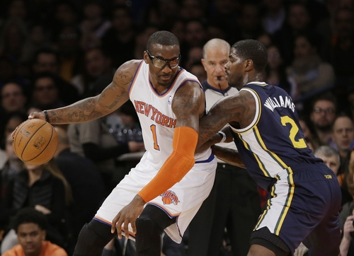 Utah Jazz's Marvin Williams (2) defends New York Knicks' Amare Stoudemire (1) during the first half of an NBA basketball game on Friday, March 7, 2014, in New York. (AP Photo/Frank Franklin II)