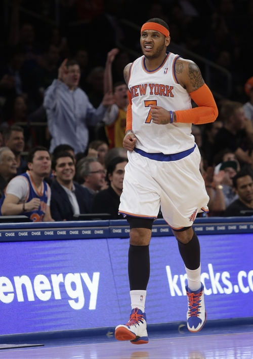 New York Knicks' Carmelo Anthony (7) reacts after scoring during the first half of an NBA basketball game against the Utah Jazz, Friday, March 7, 2014, in New York. (AP Photo/Frank Franklin II)