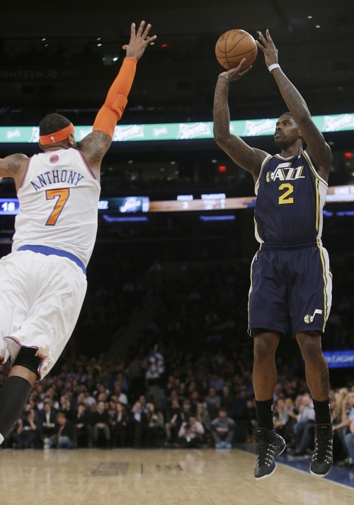Utah Jazz's Marvin Williams (2) shoots over New York Knicks' Carmelo Anthony (7) during the first half of an NBA basketball game on Friday, March 7, 2014, in New York. (AP Photo/Frank Franklin II)